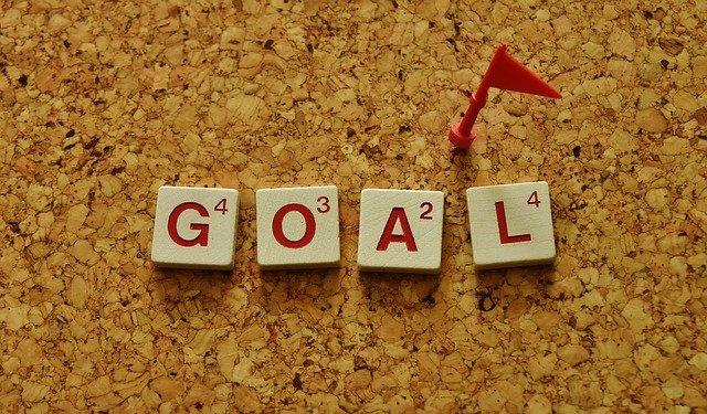 goal écrit sur une table